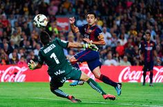 Xavi Hernandez of FC Barcelona scores the opening goal past Xabi Irureta of SD Eibar during the La Liga match between FC Barcelona and SD Eibar at Camp Nou on October 18, 2014 in Barcelona, Catalonia.