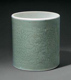 A celadon-glazed carved cylindrical brush pot, China, Qing dynasty, Kangxi period (1662-1722)