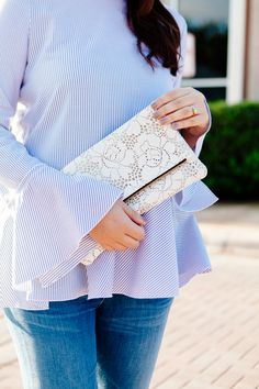 Clare V. Lace Clutch with Bell Sleeve Blouse and Ankle Jeans and Nude heels on…