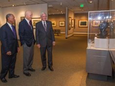 NASA - Fly Marines exhibit at the National Air and Space Museum 6/27/2012.  Left to right:  Charles Bolden, NASA Administrator; Senator John Glenn; and General John R. Dailey, director of the museum.