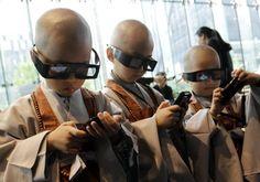 Google Image Result for http://blog.kenperlin.com/wp-content/uploads/2011/05/korean-children-at-buddhist-monastery-using-3d-smart-phones.jpg