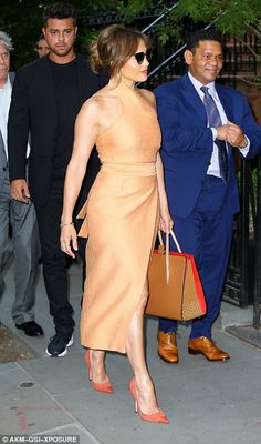 She looked dazzling in a light orange dress, matching her lips to her bright heels...