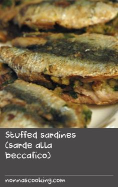 Stuffed sardines (sarde alla beccafico) | This is a dish of butterflied sardines sandwiched with a breadcrumb, parsley and parmesan stuffing. The plump stuffed fish with their tails sticking out are said to resemble the beccafico, a little bird found in Italy that loves to eat figs (fico).