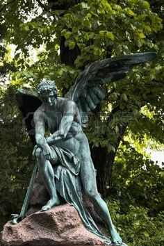 Lonely angel protecting a grave on Vienna s central cemetery Stock Photo