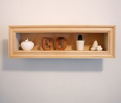 Cute DIY shelving idea for the living room made out of press borad and repurposed picture frames.