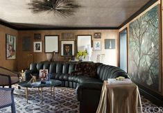 Kelly Wearstler Mercer Island Residence - A De Sede sofa makes quite the statement in the art-filled salon. Very-Kelly tchotchkes sit atop a custom coffee table.