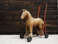 Hey, I found this really awesome Etsy listing at https://www.etsy.com/listing/281171080/vintage-pushpull-along-toy-horse