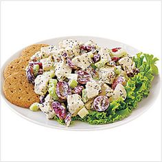 Use both mayonnaise and sour cream to add creaminess to this classic chicken salad.  Grapes, pecans and chopped celery all contribute texture, flavor and color to the salad.