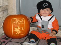 Liam dresses up as Luke Skywalker showing his Sharks pride next to a carved #Sharkoween pumpkin.