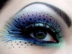 Lumiere color by Ben Nye. Use Peacock on lid, fade to Cosmic Blue, Royal Purple, Ice. Use Turquoise at the corner of the eye. Black CL29 Color Liner for the dots and lashes. Set with Final Seal Spray.
