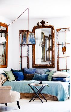 "Combine different shades of denim  ""Denim can be everything from the deepest indigo to the very brightest, soft gray-blue. When I look at this picture again, I would just throw me down in the kuddfyllda couch and stay there! The various shades of blue and green complement each other so beautifully and fits well with the antique mirrors and old windows at the home of the owners of Depuis Toujours in the south of France. """