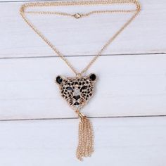 """Leopard Tassel Necklace✨2 available✨ Beautiful and elegant looking leopard necklace. This is gold plated and has CZ stones. Chain is about 28"""" and the tassel is about 2 1/2"""". New in package. Jewelry Necklaces"""