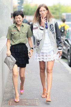 military-esque shirt+ black flouncey skirt+coloured pumps+big clutch. likey