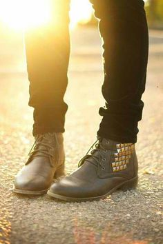 Studded lace up boots.
