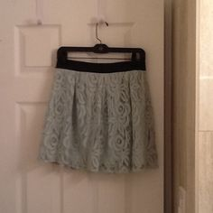 BCBGeneration lined lace skirt. New with tags. Mint green lace lined skirt brand new with tags attached. The skirt has a leather like trim on the waist in the front and is elasticized in the back.  I am 5'4 and the skirt would hit just above the knee. BCBGeneration Skirts