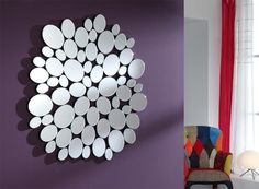 Contemporary wall mirror made up of individual pebble and round mirrors