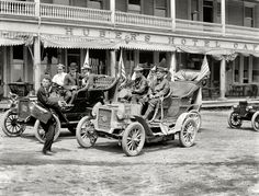 """Cross-Country: New York, June 1906. """"REO Mountaineer, New York to San Francisco and back."""" Percy Megargel and David Fassett pass Huber's Hotel on 162nd Street in the Bronx at the end of their 10-month, 11,000-mile trip in a 16-horsepower touring car. Note the unpaved street at the present-day location of Yankee Stadium. 8x10 inch dry plate glass negative, Detroit Publishing Company.  Click to view full size."""
