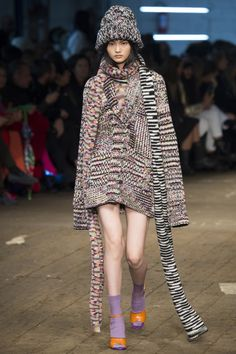 A model wears a knitted beaning, cardigan and long scarf from Missoni's fall-winter 2016 collection