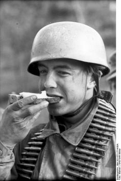 """No army can march without """"beef and beer,"""" Wellington once said. In this particular case of a German paratrooper, the march depends on chewing on a thick slice of bread topped with a slice of cheese (?). German field rations included some pretty advanced items for their time, including a potion that produced instant coffee and various cans with meat paste offering high protein intake (taste could be debated)."""
