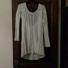 Long Free People Sweater Semi-sheer, soft, loose knit, white Free People Sweater with an open back and a tie at the top of the opening Free People Sweaters Crew & Scoop Necks