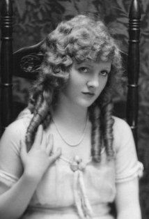 Mary Miles Minter was an American actress. She appeared in 54 silent era motion pictures from 1912 to 1923. In 1922, Minter was involved in scandal surrounding the murder of director William Desmond Taylor, whom she professed her love for. Although gossip implicated her mother, Charlotte Shelby, as the murderer, Minter's reputation as a demure young lady was tarnished.  Minter, whose mother was a shrewd businesswoman and invested her daughter's money wisely, gave up her movie career in 1923.