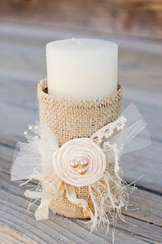 burlap covered tin cans as candle holders.