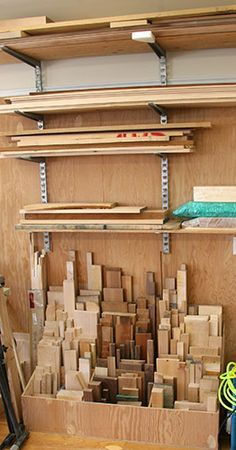 Material Storage: For storing shorter lengths of solid wood I built a stepped storage bin out of 1/2″ plywood that allows me to organize and group by length and species.  For storage of longer scraps of solid wood and lengths of lumber that I am currently working with I have a wood storage system mounted on the wall above my scrap bin.  This allows me easy access to whatever piece of wood I need.  Sheet goods get stored against the wall.