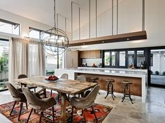 The open-concept kitchen and living room experts at HGTV.com share 15 designers' tricks for creating multifuctional spaces with flow.