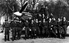 Group portrait of pilots 308th (Polish) Squadron RAF (No. 308 (Polish) Squadron RAF) fighter in 'Spitfire' Mk.IX (Supermarine Spitfire Mk.IX).