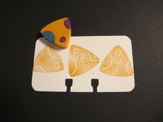 Carved triangle stamp.