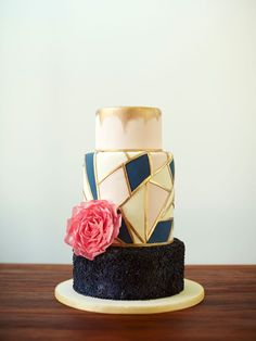 This non-traditional wedding cake, with its unique pattern, hand-painted gold details and glittering lower tier, was inspired by modern geometric stationery.