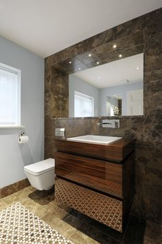 Wall hung wc, bespoke furniture, recessed mirror with LED lighting.