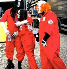 """Slipknot-Between the awkward angle Joey's standing at and the clothesline grip Mick has on him, I can't hear anything other than   """"This is mine, mess with him and die""""  coming from this pic.  Am I alone?"""