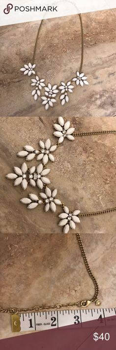 "J. Crew statement bib necklace white flower bling Gorgeous statement necklace by J. Crew. Brass color gold hard wear. White flower w clear round bezel crystals. One rectangle crystal also in center flower only. Each floret ranges from 1.25"" to 2"" in length...short to long from outside to center. Total chain length is 17"" with 3"" extender for 20"" total. Strong lobster claw clasp, w J. Crew tag charm. Great cond. worn 1x. J. Crew Jewelry Necklaces"
