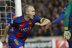 Barcelona's midfielder Andres Iniesta celebrates Paris Saint-Germain's own goal during the UEFA Champions League round of 16 second leg football match FC Barcelona vs Paris Saint-Germain FC at the Camp Nou stadium in Barcelona on March 8, 2017. / AFP PHOTO / PAU BARRENA