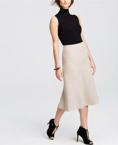 """Flowy and feminine, our flared sweater skirt is your newest wardrobe staple. Encased elastic waistband. 28 1/2"""" long."""