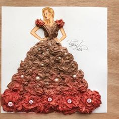 Cake queen   Made with chocolate cream  and edible pearls   Hope you like it guys It was one of the most difficult ones I spent hours trying to give a shape of the dress. Hope you like the result.