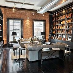 | Cozy library Den | Loft | The Layout , choice of colours, furniture, brick wall and black window frames are impeccable |