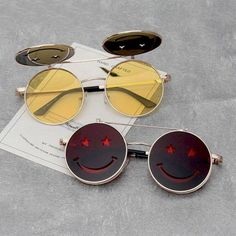 Unisex 'Smiley Face' Flip Lens Funny Happy Sunglasses Astroshadez--$14.99--How fantastic it is to share sunglasses between couples. Our unisex sunglasses would leave you mesmerized. The best thing is you can buy a few and swap between you and your friends and achieve different looks easily. We offer sunglasses in different colors, shapes, and style to complement your wardrobe. Try our classic shades that would add oomph to your formal attires or the modern and colorful ones to add zest to your c Funky Glasses, Cool Glasses, Cute Jewelry, Jewelry Accessories, Fashion Accessories, Cute Sunglasses, Round Sunglasses, Sunnies, Fashion Eye Glasses