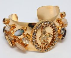 24 K Yellow Gold Plated Fabulous Cuff Bracelet by Amaro Jewelry Studio 'Aura' Collection Adorned with Dragon Ornament, Tiger Eye, Pyrite, Abalone, Desert Jasper, Aragonite, Mexican Crazy Lace Agate and Swarovski Crystals Amaro. $452.00. Aura Collection pi Semi Precious Gemstones, Natural Gemstones, 24k Gold Jewelry, Crazy Lace Agate, Jasper, Bracelet Watch, Swarovski Crystals, Jewelry Bracelets, Gem Stones
