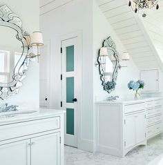 Venetian mirrors atop vanities in bathroom. pretty-palettes-coastal-hues