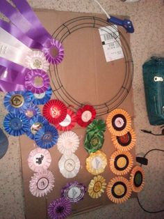 This is such a good idea!  I wish I would have kept some of Grandpa's ribbons now!!! Wreath from Michaels, glue gun and horse show ribbons