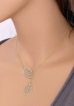 Show your love to Mother Nature in this gold leaf necklace. It's simple and you can brighten your daily outfit with this metal necklace. It features two leaves design and has an adjustable lobster clasp closure. This necklace is made of base metal and is 21.3 inches long.