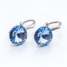 Swarovski Rivoli Earrings 8mm Light Sapphire  Dimensions: length: 1,7cm stone size: 8mm Weight ~ 1,85g ( 1 pair ) Metal : sterling silver ( AG-925) Stones: Swarovski Elements 1122 SS39 Colour: Light Sapphire 1 package = 1 pair
