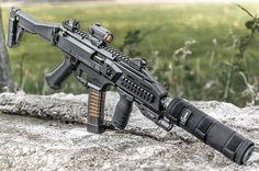 When you're almost too tacticool. Awesome shot of the Scorpion EVO by Airsoft Guns, Weapons Guns, Guns And Ammo, Arsenal, Evo, Submachine Gun, Custom Guns, Military Guns, Cool Guns