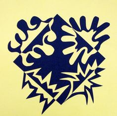 """Students learned about the Japanese principles of Notan which means """"dark light,"""" before creating their cut paper designs. They concentrated on creating balanced designs with equal amounts of positive and negative space as they expanded the square."""