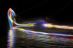 """Orlando's LED-lit wakeboarding entry in Red Bull Illume, """"the world's premier international photography competition dedicated to the world of action and adventure sports. Red Bull, Wakeboarding Girl, Kalender Design, Led, Wakeboard Boats, Dallas, Sup Surf, Photography Competitions, Water Photography"""