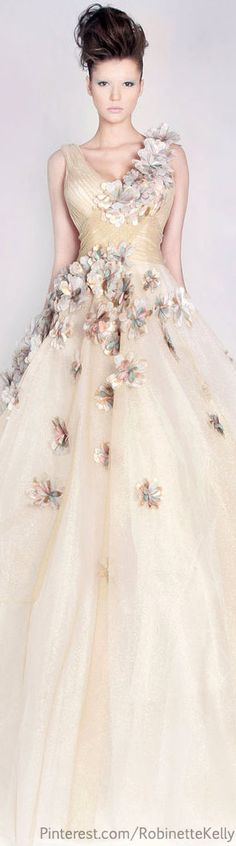 Rami Kadi Couture   S/S 2013. Princess style ball gown.  Ivory, silk shantung, tulle and floral appliques.  Summer and femininity combined.