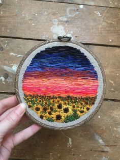 5 hoop on natural linen. Over 25 colours blended together to create this vivid sky, a warm Kansas night. A full sunflower field with French knot middles,