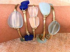 Clear Sea Glass Wire Wrapped Gold Bangle by SunandStoneJewelry, $28.00.   Love these sea glass bangles.